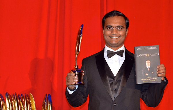 Praveen Narra receiving Quilly Award