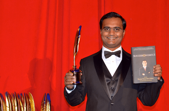 Praveen Narra receiving Quilly Award