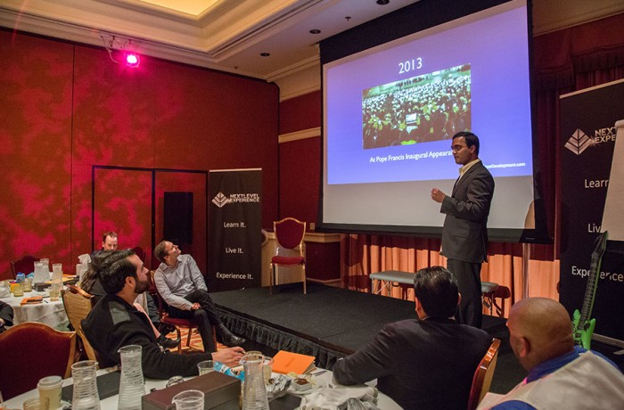Praveen Narra speaking at The Next Level Experience in Las Vegas