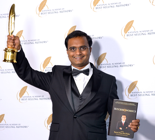 Praveen Narra receiving Quilly Award for his Book